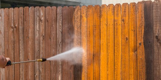 power washing a dirt fence