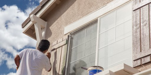 a good power wash. will prime the area perfectly so that you or a professional team can paint a nice, even coat on the outside of your home.